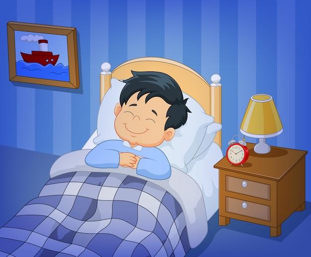 침대에서 자고 만화 미소 어린 소년