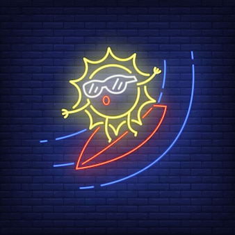 Cartoon sun on surfboard neon sign. cute character surfing on brick wall