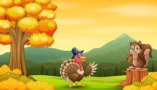 Cartoon turkey with squirrel in the autumn landscape