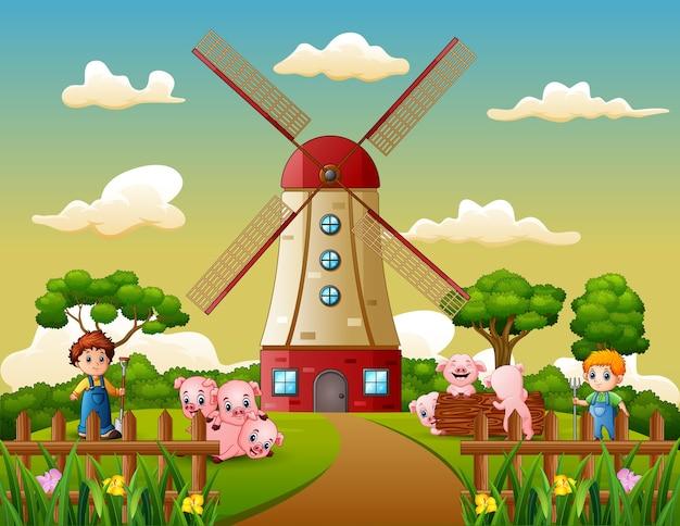 만화 두 소년 풍차 건물 배경에서 돼지를 모으고있다