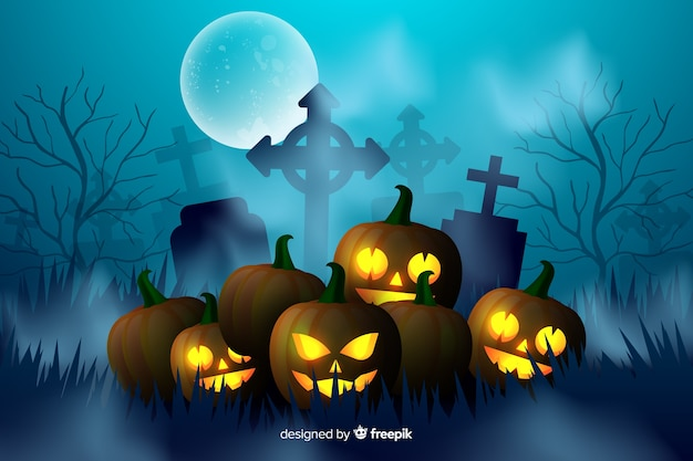 Carved orange pumpkins in cemetery background