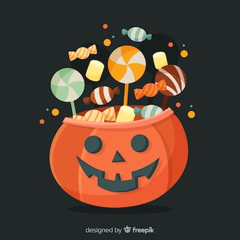 Carved pumpkin with candies for halloween