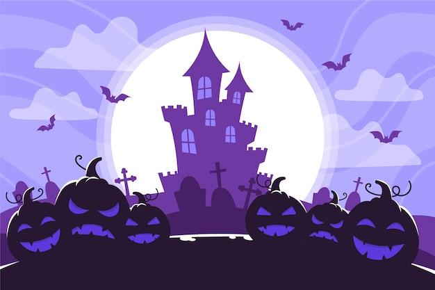 城のシルエットと満月のハロウィーンの背景