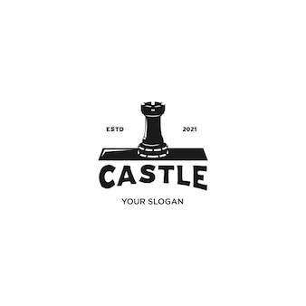 白で隔離される城のシルエットのロゴ