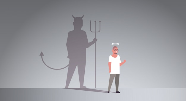 Casual guy with nimbus choosing between good and evil shadow of devil