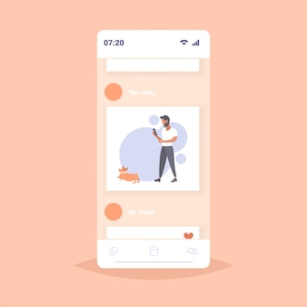 Casual man walking with dog bearded guy using smartphone male person having fun with his animal pet best friend concept smartphone screen mobile app  full length