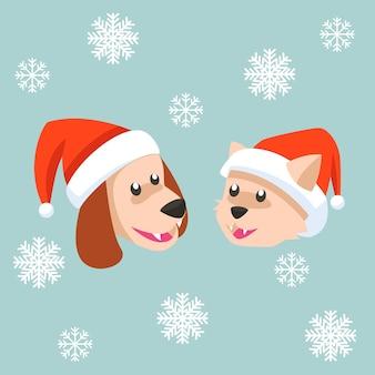 배경에 눈송이와 크리스마스 비니를 입고 고양이와 개