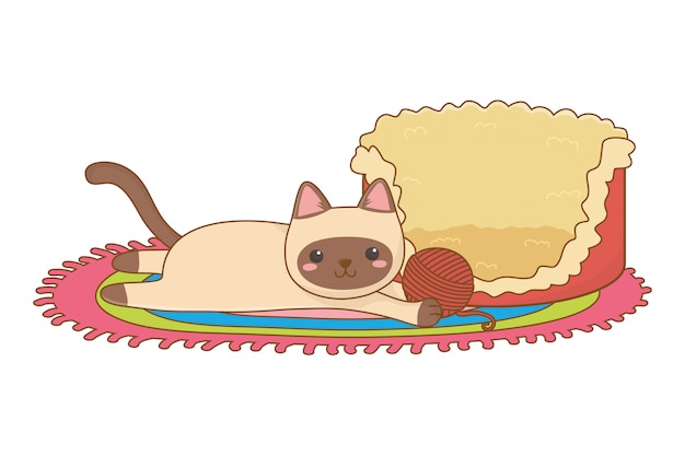 Кошка играет с клубком шерсти