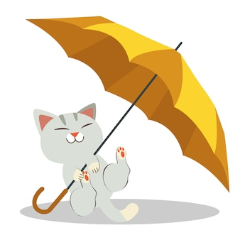 The cat playing with the yellow umbrella . the cats look happy and relaxing.