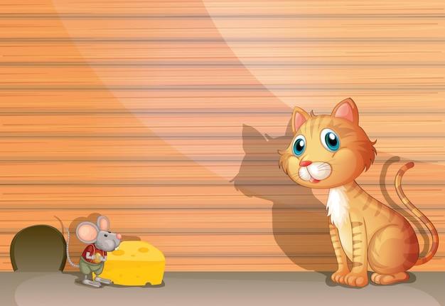 Un gatto e un topo Vettore gratuito