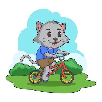 Кошка езда на велосипеде