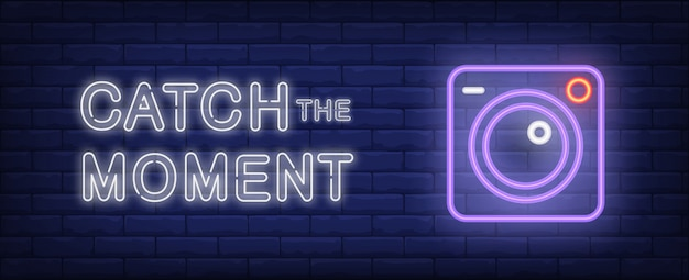 Catch the moment illustration in neon style. text and camera on brick wall background.