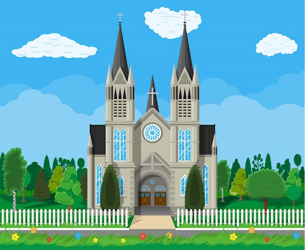 Catholic church cathedral with trees and fence