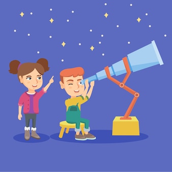 Caucasian boy looking at stars through a telescope
