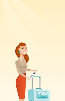 수하물 태그를 보여주는 백인 비즈니스 여자.