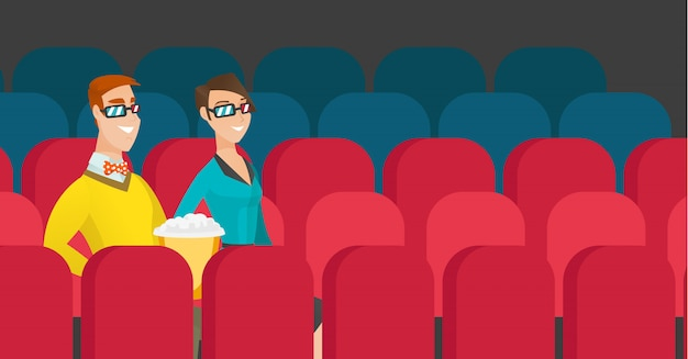 Caucasian couple watching 3d movie in the cinema