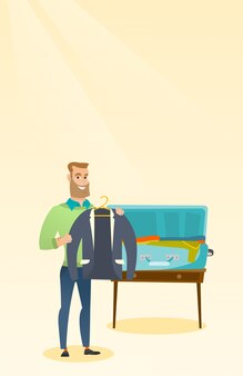 Caucasian man packing clothes in a suitcase