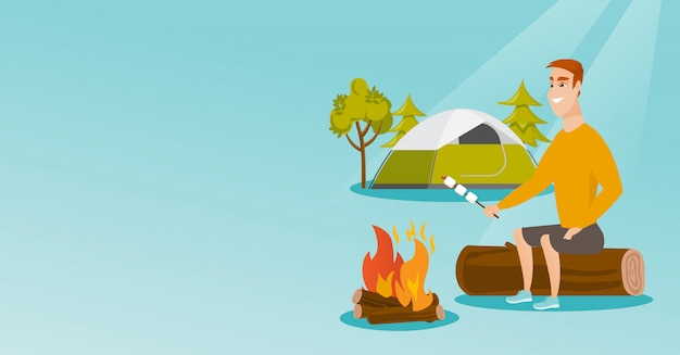 Caucasian man roasting marshmallow over campfire.