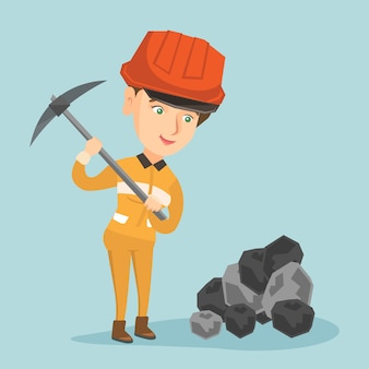 Caucasian miner in hard hat working with a pickaxe