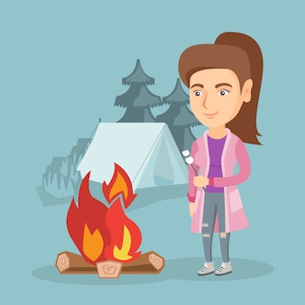 Caucasian woman roasting marshmallow over campfire