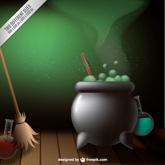 Cauldron for halloween and a broom