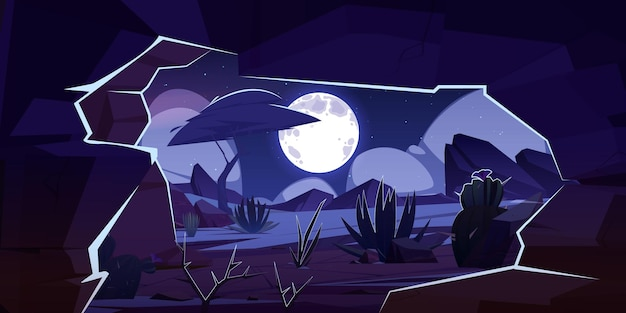 Cave in rock and desert landscape at night