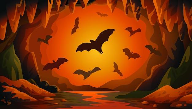 日没時にコウモリと洞窟
