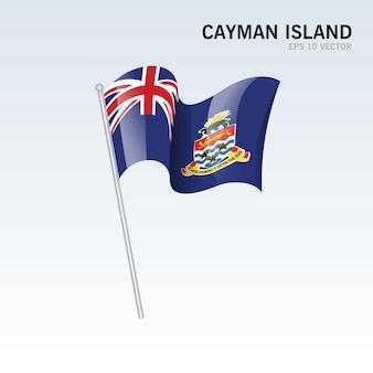 회색에 고립 된 깃발을 흔들며 케이맨 제도