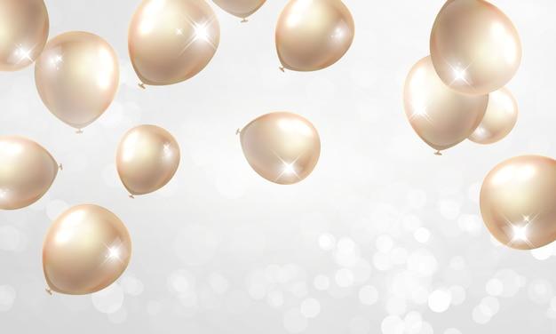 金色の風船でお祝いパーティーの背景。