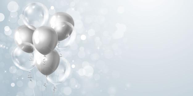 灰色の風船とお祝いパーティーバナー