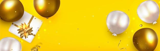 風船とお祝いの黄色のテンプレート