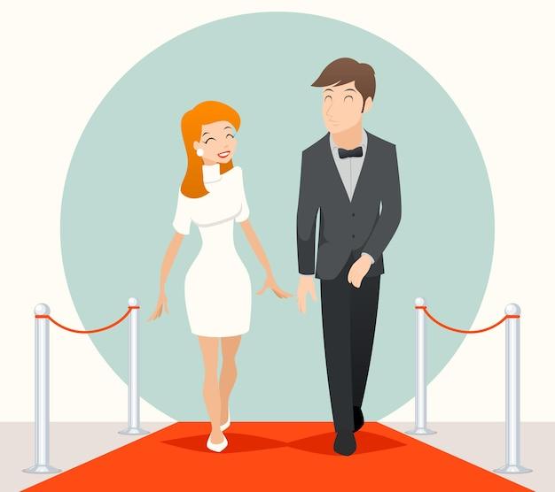 レッドカーペットの上を歩いている有名人のカップル。レッドカーペットでのカップル、人々の結婚、レッドカーペットでの2人の俳優、レッドカーペットでの結婚式。