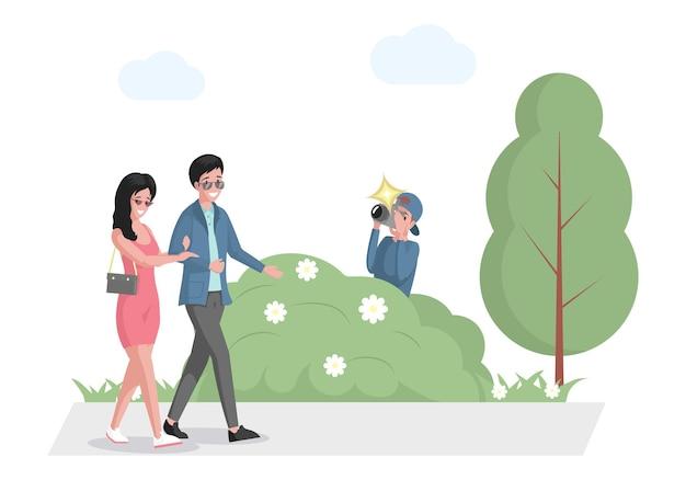 と茂みに隠れて公園パパラッチを歩いている有名人のカップル