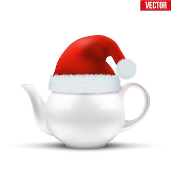Ceramic teapot with christmas hat of santa claus.