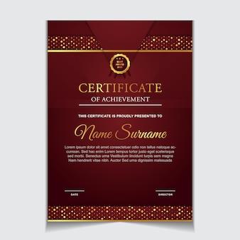 豪華な金と赤の色のモダンな形の証明書テンプレートデザイン
