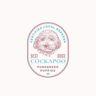 認定犬の繁殖者のフレームバッジまたはロゴテンプレート。レトロなタイポグラフィとボーダーの手描きコッカプー子犬の顔のスケッチ。ヴィンテージプレミアムエンブレム。孤立