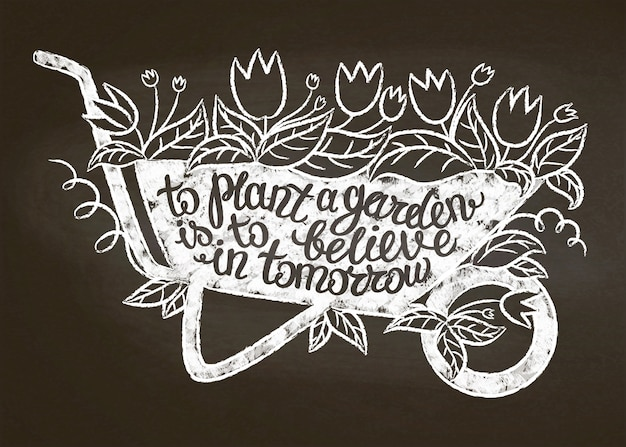Chalk silhouette of vintage garden barrow with leaves and flowers and lettering.