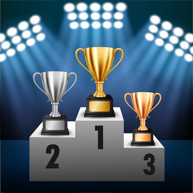 表彰台で3つのトロフィーを持つチャンピオンシップ