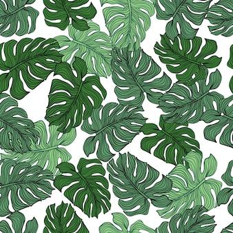白い背景の上の混沌としたモンステラの葉のシームレスなパターン