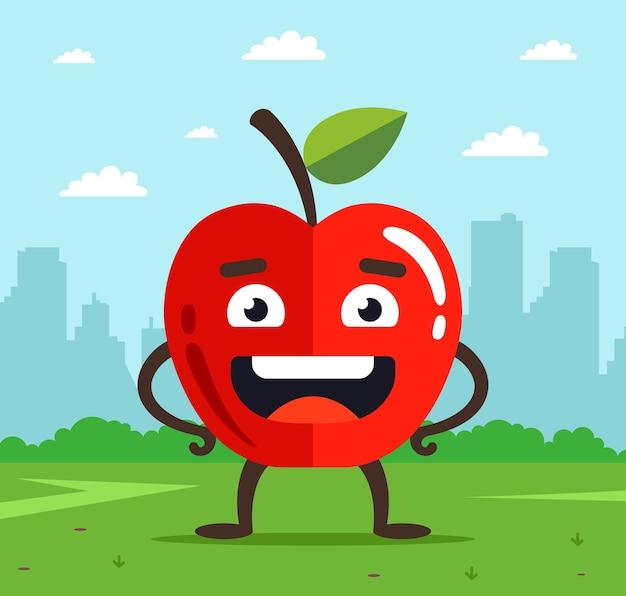Характер яблоко с лицом. плод упал с дерева на траву. городской пейзаж