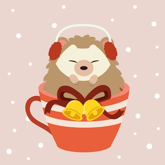 The character of cute hedgehog sitting in the big red cup on the pink backgrouns with snow.