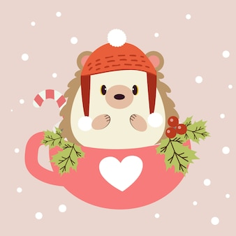 The character of cute hedgehog sitting in the pink cup with holly leaf and candy. the cute hedgehog wear a winter hat on the pink  and white snow.