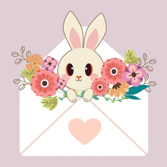 The character of cute rabbit sitting in the letter with heart sticker and flower
