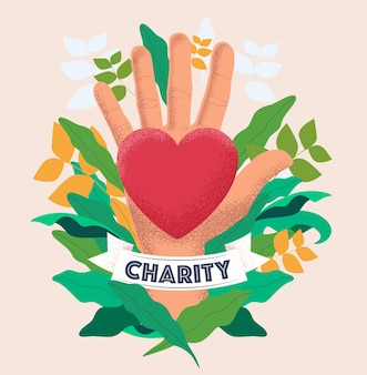 Charity and donation concept with hand palm hold red heart on floral background.