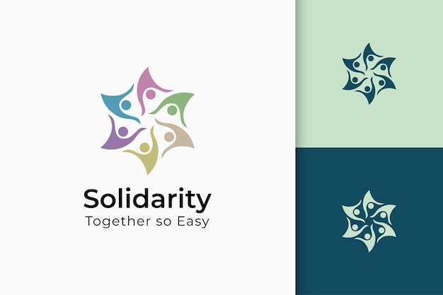 手と太陽のチャリティーまたは一緒のロゴは平和または連帯を表します
