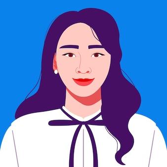 青い背景の上のビジネス服装の魅力的な若い女性