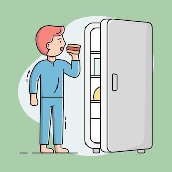 チートミールと健康的なライフスタイルのコンセプト。若い男は冷蔵庫からホットドッグを食べています。男性キャラクターは彼の食事療法で浮気し、不健康な食事を食べています