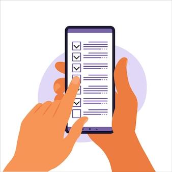 스마트폰 화면의 체크리스트. 온라인 설문 조사 개념입니다. 손에는 확인 표시가 있는 휴대 전화와 확인 목록이 있습니다. 벡터 일러스트 레이 션. 평평한