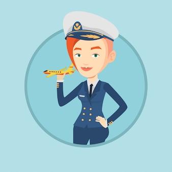 모형 비행기와 쾌활 한 항공사 조종사입니다.