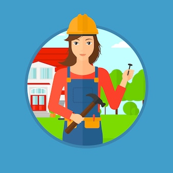 Cheerful builder with hammer.
